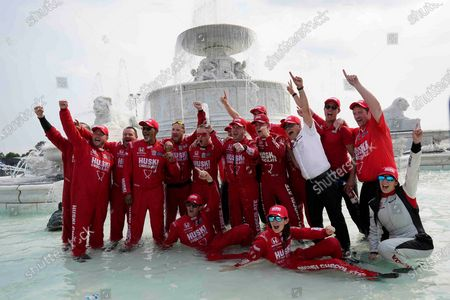 Chip Ganassi engineer Angela Ashmore is shown sitting in the water, second from bottom right, next to Nicole Rotondo, an engineer with Honda Performance Development, bottom far right, as the team celebrates in a fountain after Marcus Ericsson of Sweden won the first race of the IndyCar Detroit Grand Prix auto racing doubleheader on Belle Isle in Detroit on . The last three IndyCar races have been won by drivers who have female engineers on their teams, a trend that could continue Sunday at Mid-Ohio Sports Car Course