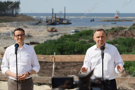 President Andzej Duda (R) and PM Mateusz Morawiecki (L) visiting the construction site of a waterway connecting the Vistula Lagoon with the Gulf of Gdansk are seen in Nowy Swiat, Vistula Spit, Poland on 1 July 2021 Controversial The Vistula Spit canal is curently under construction canal across the Polish section of the Vistula Spit that will create a second connection between the Vistula Lagoon and Gdansk Bay (Baltic Sea)