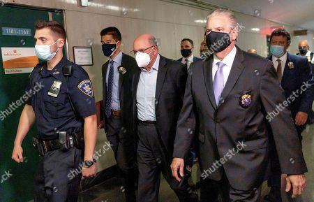 Allen Weisselberg (C), the chief financial officer for the Trump Organization, is escorted by police officers into a court hearing after he turned himself in this morning to face an indictment brought by the Manhattan district attorney's office at Manhattan Criminal Court in New York, New York, USA, 01 July 2021. The Trump Organization, the family business of former US President Donald J. Trump, and Weisselberg have been indicted for alleged tax crimes related to unreported fringe benefits given to employees of company, charges that are result of a years long investigation by Manhattan District Attorney Cy Vance and New York State Attorney General Letitia James.