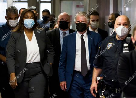 New York State Attorney General Letitia James (L) and Manhattan District Attorney Cy Vance (2-R) depart a hearing for Allen Weisselberg, the chief financial officer for the Trump Organization, for an indictment brought by the Manhattan district attorney's office at Manhattan Criminal Court in New York, New York, USA, 01 July 2021. The Trump Organization, the family business of former US President Donald J. Trump, and Weisselberg have been indicted for alleged tax crimes related to unreported fringe benefits given to employees of company, charges that are result of a years long investigation by Vance's and James' offices.