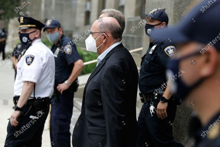 Allen Weisselberg, (C) the chief financial officer for the Trump Organization, departs from court after a hearing related to an indictment by the Manhattan district attorney's office in New York, New York, USA, 01 July 2021. The Trump Organization, the family business of former US President Donald J. Trump, and Weisselberg have been indicted for alleged tax crimes related to unreported fringe benefits given to employees of company, charges that are result of a years long investigation by Manhattan District Attorney Cy Vance and New York State Attorney General Letitia James.