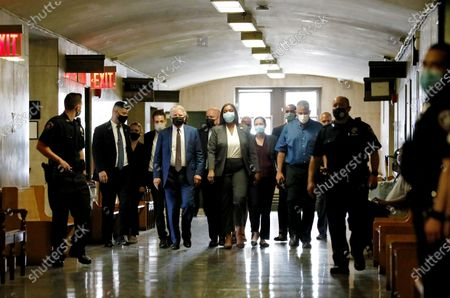 New York State Attorney General Letitia James (C) and Manhattan District Attorney Cy Vance (3-L) arrive for a hearing for Allen Weisselberg, the chief financial officer for the Trump Organization, for an indictment brought by the Manhattan district attorney's office at Manhattan Criminal Court in New York, New York, USA, 01 July 2021. The Trump Organization, the family business of former US President Donald J. Trump, and Weisselberg have been indicted for alleged tax crimes related to unreported fringe benefits given to employees of company, charges that are result of a years long investigation by Vance's and James' offices.