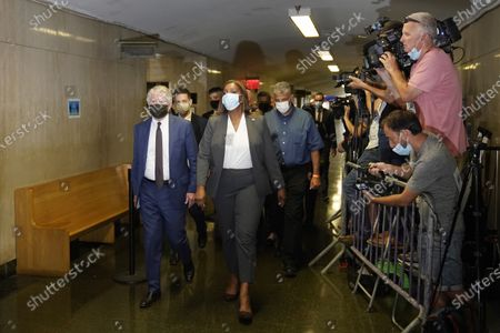 """Manhattan District Attorney, Cyrus Vance, Jr., left, and the Attorney General of New York Letitia James, second from left, arrive to a courtroom in New York, . Donald Trump's company and its longtime finance chief were charged Thursday in what a prosecutor called a """"sweeping and audacious"""" tax fraud scheme that saw the Trump executive allegedly receive more than $1.7 million in off-the-books compensation, including apartment rent, car payments and school tuition"""
