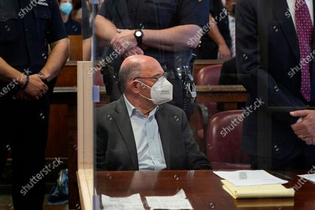 Allen Weisselberg (C), the chief financial officer for the Trump Organization, sits in a court room during a hearing after he turned himself in this morning to face an indictment brought by the Manhattan district attorney's office at Manhattan Criminal Court in New York, New York, USA, 01 July 2021. The Trump Organization, the family business of former US President Donald J. Trump, and Weisselberg have been indicted for alleged tax crimes related to unreported fringe benefits given to employees of company, charges that are result of a years long investigation by Manhattan District Attorney Cy Vance and New York State Attorney General Letitia James.
