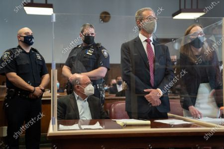 Allen Weisselberg (L), the chief financial officer for the Trump Organization, sits in a court room during a hearing after he turned himself in this morning to face an indictment brought by the Manhattan district attorney's office at Manhattan Criminal Court in New York, New York, USA, 01 July 2021. The Trump Organization, the family business of former US President Donald J. Trump, and Weisselberg have been indicted for alleged tax crimes related to unreported fringe benefits given to employees of company, charges that are result of a years long investigation by Manhattan District Attorney Cy Vance and New York State Attorney General Letitia James.