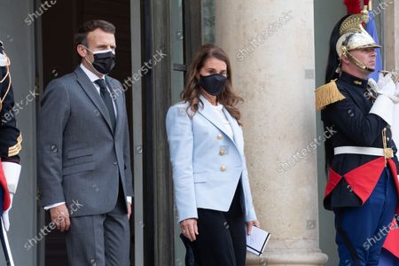 French President Emmanuel Macron escorts Melinda Gates after a meeting at the Elysee Palace in Paris