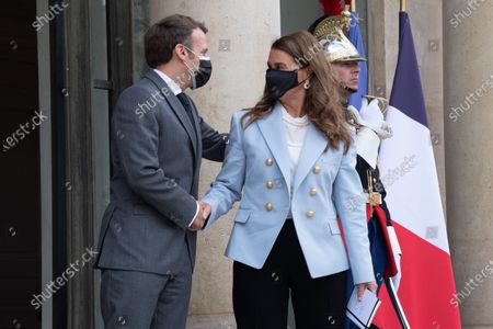 Stock Picture of French President Emmanuel Macron escorts Melinda Gates after a meeting at the Elysee Palace in Paris