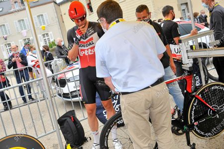 Roger Kluge (GER) is waiting for his bike to be checked by UCI officials at the start of stage 05 of Tour de France cycling race, an Individual Time Trial over 27.2 kilometers (16.9 miles) with start in Change and finish in Laval, France