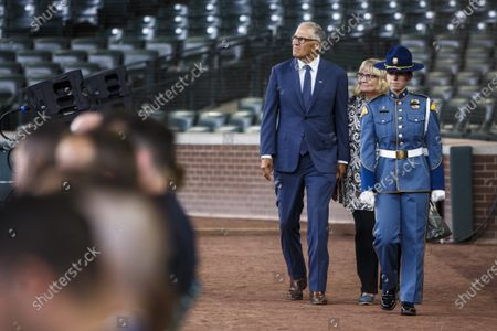 """Governor Jay Inslee and his wife Trudi Inslee arrive at the memorial service for Seattle police officer Alexandra """"Lexi"""" Harris at T-Mobile Park on in Seattle. Harris was fatally struck by a car while helping people involved in a crash"""