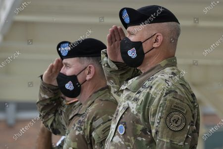 Incoming commander, Gen. Paul J. LaCamera, right, and outgoing commander, Gen. Robert B. Abrams salute during a change-of-command ceremony for the United Nations Command, Combined Forces Command, and United States Forces Korea at Barker Field in Pyeongtaek, South Korea