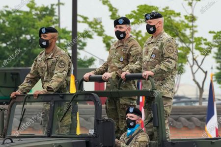 Incoming commander, Gen. Paul J. LaCamera (R) and outgoing commander, Gen. Robert B. Abrams (C), inspect the troops during a change-of-command ceremony for the United Nations Command, Combined Forces Command, and United States Forces Korea at Barker Field in Pyeongtaek, South Korea, 02 July 2021.
