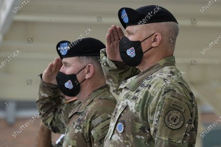 Incoming commander, Gen. Paul J. LaCamera (R) and outgoing commander, Gen. Robert B. Abrams (L) salute during a change-of-command ceremony for the United Nations Command, Combined Forces Command, and United States Forces Korea at Barker Field in Pyeongtaek, South Korea, 02 July 2021.