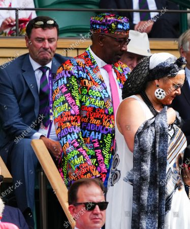 Stock Image of Phillip Brook, AELTC Chairman looking at Derrick Evans, otherwise known as Mr Motivator, in the Royal Box