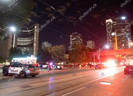 Editorial picture of Toronto police officer hit by car near City Hall, Toronto, Canada - 01 Jul 2021