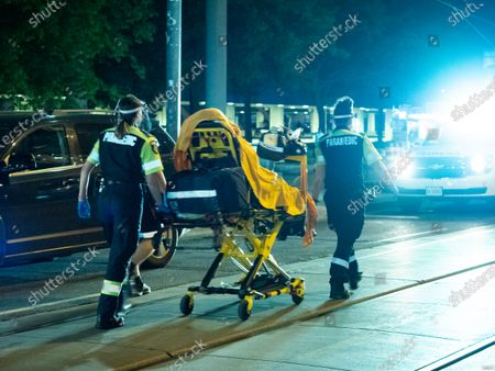 Stock Photo of A Toronto police officer is in critical condition after being hit by a car in the underground parking lot for City Hall on Queen St West.