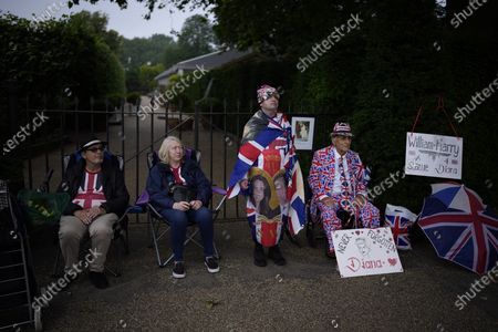 Royals fans who were the first to arrive, form the front of a queue to see the statue of Diana, Princess of Wales, a day after its unveiling, in the Sunken Garden at Kensington Palace, London, . The statue, which shows a larger-than-life Diana surrounded by three children, was commissioned by Prince William and Prince Harry in 2017. Pictured from right are: Terry Hutt, aged 86, John Loughrey, Maria Scott and a man who gave his name as Sky London