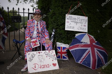 Royal fan Terry Hutt, aged 86, waits at the front of a queue to view the statue of Diana, Princess of Wales, a day after its unveiling, in the Sunken Garden at Kensington Palace, London, . The statue, which shows a larger-than-life Diana surrounded by three children, was commissioned by Prince William and Prince Harry in 2017