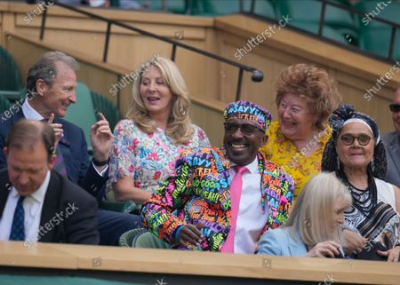 Stock Photo of Derrick Evans, otherwise known as Mr Motivator, sits in the Royal Box on Centre Court on day five of the Wimbledon Tennis Championships in London