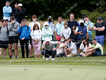 Martin Kaymer lines up his putt on the 8th green