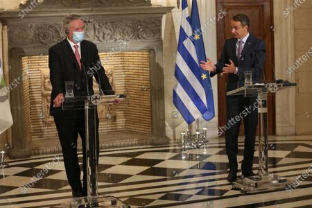 Greek Prime Minister, Kyriakos Mitsotakis (R) with the Secretary General of the Organization for Economic Cooperation and Development (OECD), Mathias Cormann (L) during a joint press conference, following a meeting at the Maximos Mansion in Athens, Greece, 02 July 2021.