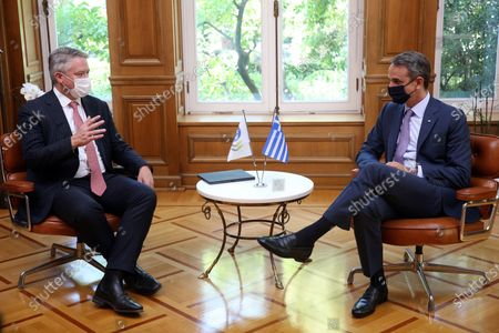 Greek Prime Minister Kyriakos Mitsotakis (R) talks with the Secretary General of the Organization for Economic Cooperation and Development (OECD), Mathias Cormann (L) during a meeting at the Maximos Mansion in Athens, Greece, 02 July 2021.