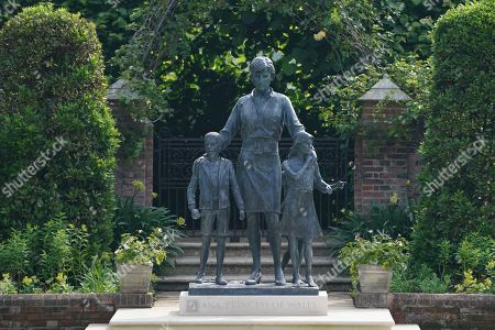 The statue of Diana, Princess of Wales, ahead of the first members of the public being allowed in to view it in the Sunken Garden at Kensington Palace, London.