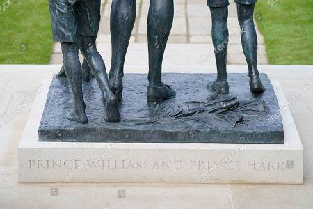 Detail of the inscription 'Prince William and Prince Harry' on the statue of Diana, Princess of Wales, ahead of the first members of the public being allowed in to view it in the Sunken Garden at Kensington Palace, London.