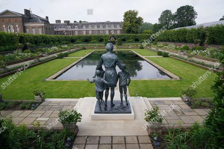 View of the statue of Diana, Princess of Wales, ahead of the first members of the public being allowed in to view it in the Sunken Garden at Kensington Palace, London.
