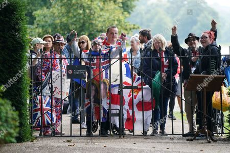 Members of the public wait to be let in to view the statue of Diana, Princess of Wales, in the Sunken Garden at Kensington Palace, London.