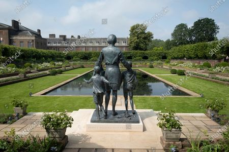 The new statue of the late Princess Diana in the new landscaped Sunken Garden of Kensington Gardens.