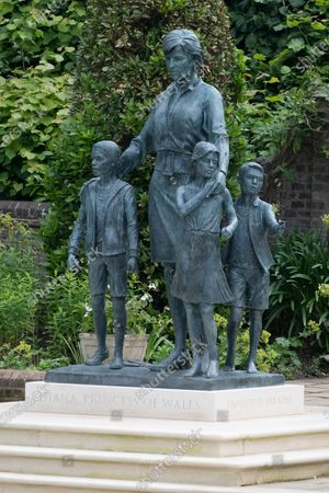 Stock Photo of The new statue of the late Princess Diana in the new landscaped Sunken Garden of Kensington Gardens.