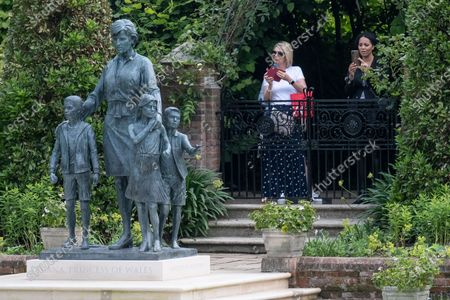 Stock Picture of The new statue of the late Princess Diana in the new landscaped Sunken Garden of Kensington Gardens.