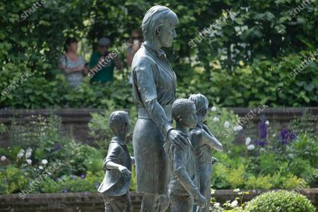 Stock Image of The new statue of the late Princess Diana in the new landscaped Sunken Garden of Kensington Gardens.