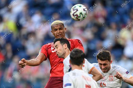 Switzerland's Manuel Akanji heads the ball during the Euro 2020 soccer championship quarterfinal match between Switzerland and Spain, at the Saint Petersburg stadium in Saint Petersburg