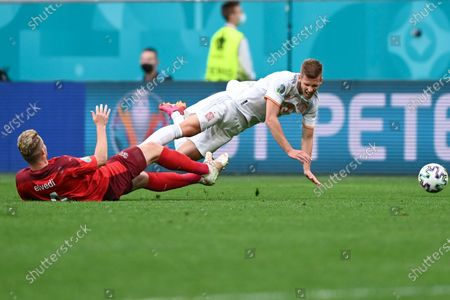 Spain's Dani Olmo is tackled by Switzerland's Nico Elvedi during the Euro 2020 soccer championship quarterfinal match between Switzerland and Spain, at the Saint Petersburg stadium in Saint Petersburg
