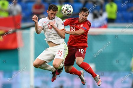 Spain's Aymeric Laporte, left, and Switzerland's Mario Gavranovic vie for the ball during the Euro 2020 soccer championship quarterfinal match between Switzerland and Spain, at the Saint Petersburg stadium in Saint Petersburg