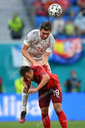 Spain's Aymeric Laporte, top, and Switzerland's Mario Gavranovic vie for the ball during the Euro 2020 soccer championship quarterfinal match between Switzerland and Spain, at the Saint Petersburg stadium in Saint Petersburg