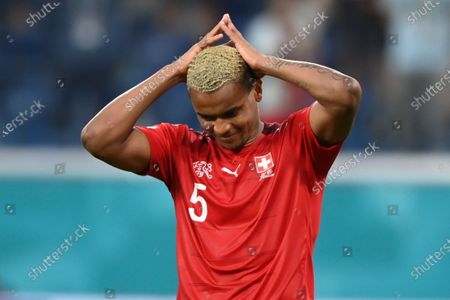Switzerland's Manuel Akanji reacts after missing a shootout penalty during the Euro 2020 soccer championship quarterfinal match between Switzerland and Spain, at the Saint Petersburg stadium in Saint Petersburg