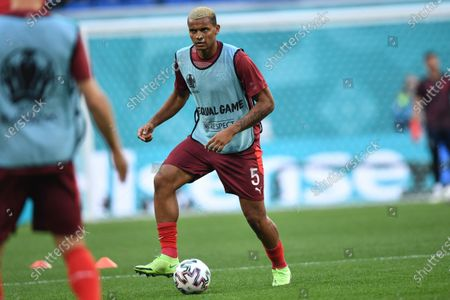 Switzerland's Manuel Akanji goes for the ball as he warms up prior to the Euro 2020 soccer championship quarterfinal match between Switzerland and Spain, at the Saint Petersburg stadium in Saint Petersburg
