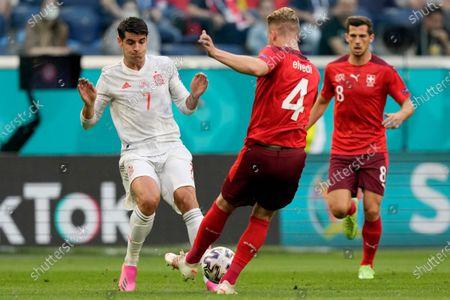 Switzerland's Nico Elvedi vies for the ball with Spain's Alvaro Morata, left, during the Euro 2020 soccer championship quarterfinal match between Switzerland and Spain at Saint Petersburg stadium in St. Petersburg, Russia