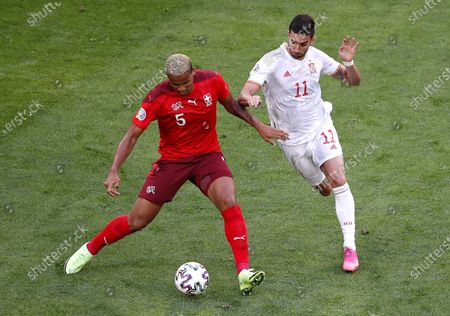 Manuel Akanji (L) of Switzerland in action against Ferran Torres (R) of Spain during the UEFA EURO 2020 quarter final match between Switzerland and Spain in St.Petersburg, Russia, 02 July 2021.