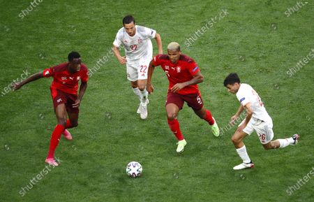 Manuel Akanji (2-R) of Switzerland in action against Pablo Sarabia (R) of Spain during the UEFA EURO 2020 quarter final match between Switzerland and Spain in St.Petersburg, Russia, 02 July 2021.