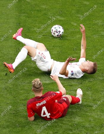 Nico Elvedi (front) of Switzerland in action against Dani Olmo (back) of Spain during the UEFA EURO 2020 quarter final match between Switzerland and Spain in St.Petersburg, Russia, 02 July 2021.