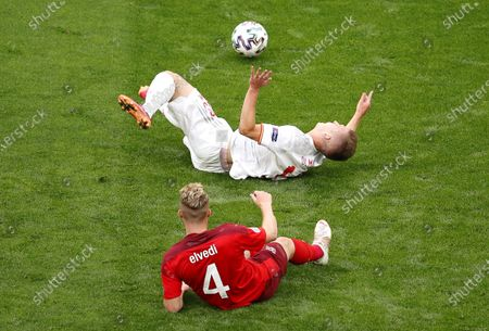 Stock Picture of Nico Elvedi (front) of Switzerland in action against Dani Olmo (back) of Spain during the UEFA EURO 2020 quarter final match between Switzerland and Spain in St.Petersburg, Russia, 02 July 2021.