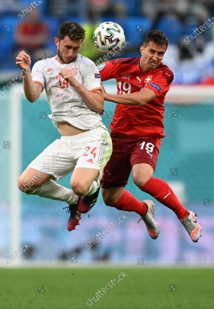 Aymeric Laporte (L) of Spain in action against Mario Gavranovic of Switzerland during the UEFA EURO 2020 quarter final match between Switzerland and Spain in St.Petersburg, Russia, 02 July 2021.