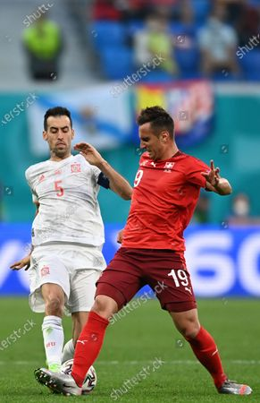 Stock Image of Sergio Busquets (L) of Spain in action against Mario Gavranovic of Switzerland during the UEFA EURO 2020 quarter final match between Switzerland and Spain in St.Petersburg, Russia, 02 July 2021.
