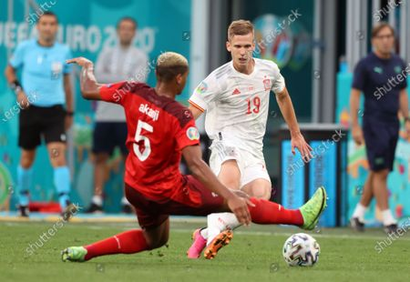 Manuel Akanji of Switzerland (L) in action against Dani Olmo of Spain during the UEFA EURO 2020 quarter final match between Switzerland and Spain in St.Petersburg, Russia, 02 July 2021.
