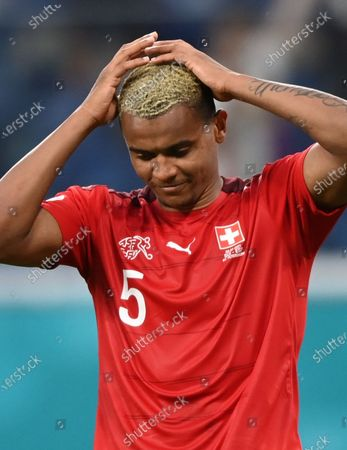 Manuel Akanji of Switzerland reacts after failing to score during the penalty shoot-out of the UEFA EURO 2020 quarter final match between Switzerland and Spain in St.Petersburg, Russia, 02 July 2021.