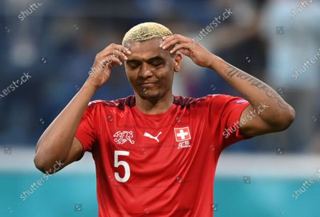 Stock Photo of Manuel Akanji of Switzerland reacts after failing to score during the penalty shoot-out of the UEFA EURO 2020 quarter final match between Switzerland and Spain in St.Petersburg, Russia, 02 July 2021.