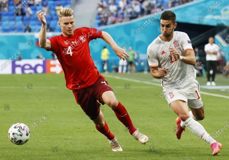 Stock Image of Ferran Torres of Spain in action against Nico Elvedi (L) of Switzerland during the UEFA EURO 2020 quarter final match between Switzerland and Spain in St.Petersburg, Russia, 02 July 2021.